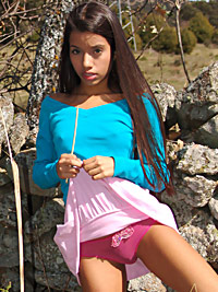 Latina teen showing off her skin outdoor